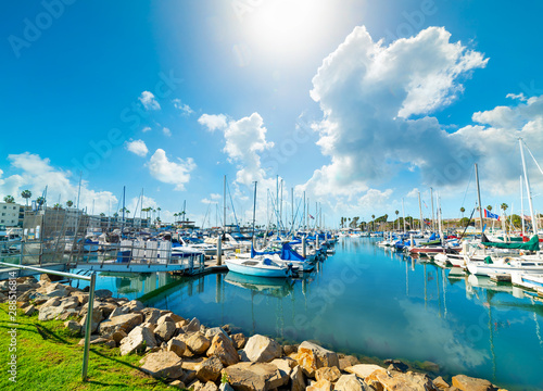 Canvas Print Oceanside harbor under a blue sky with clouds
