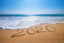 Happy New Year 2020 Is Coming Concept Sandy Tropical Ocean Beach Lettering. Exotic New Year Celebration Concept Image.