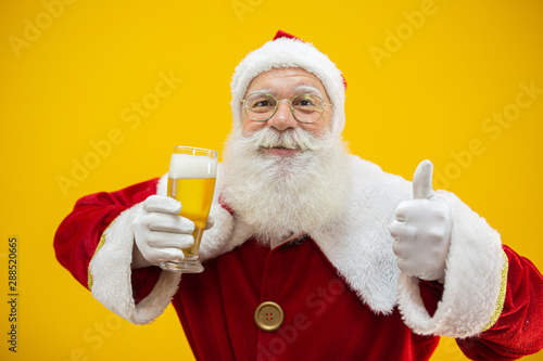Santa Claus drinking a glass of beer Slika na platnu