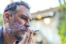 Portrait Of A Man Smoking Ciga...
