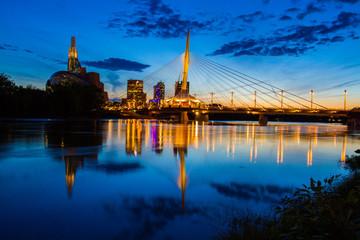 Iconic bridge at night gracing the Winnipeg downtown skyline