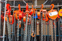 Multiple Chain Hoists Hanging In A Rack Ready For Use In A Industrial Environment, Picture Taken In The Netherlands