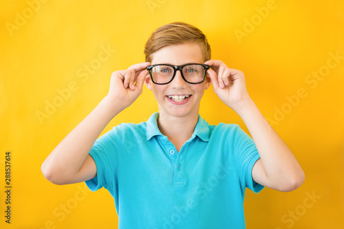 Pinturas sobre lienzo  Handsome teen boy wears glasses. Poor vision and medicine concept