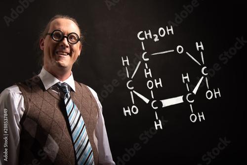 Photo Professor presenting handdrawn chemical formula of glucose