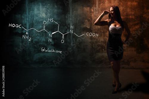 Sexy girl or secretary or female student presenting handdrawn chemical formula o Canvas Print