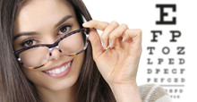 Eye Examination, Woman Smiling With Spectacles Isolated In Optician Office With Eye Chart On White Background, Prevention And Control Eyesight