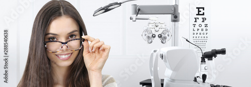 Fotomural  concept of eye examination, woman patient smiling with spectacles isolated in op