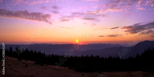 Foto auf AluDibond Flieder Rising sun with colorful skyline over the mountains in early morning