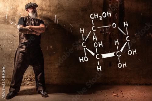 Bearded old man presenting handdrawn chemical formula of glucose Wallpaper Mural