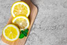 Slices Of Lemon With Mint Leav...
