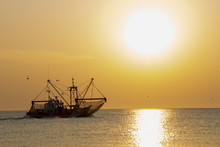 A Fish Trawler In The North Sea, Waddenzee At Sunset