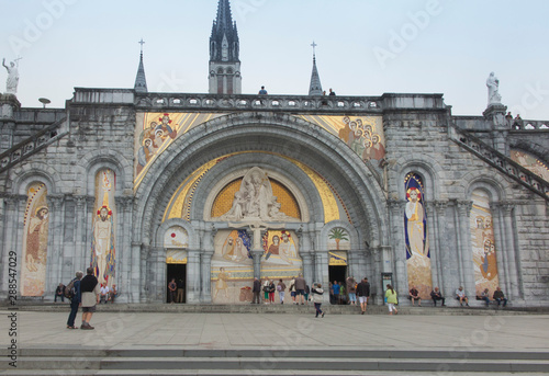 Photo  Lourdes, France, 24 June 2019: Front of the richly decorated entrance to the Ros
