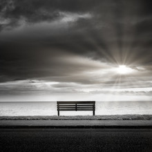 Bench And Moody Sky