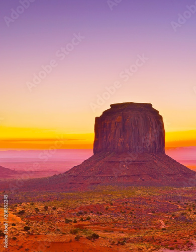 Foto auf Leinwand Rosa hell View of Monument Valley at dawn near the border of Arizona and Utah in Navajo Nation Reservation in USA.