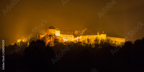 The fortress Koenigstein shrouded in fog at night, Germany Canvas Print