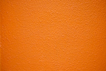 Saturated Intensive Orange Textured Surface.