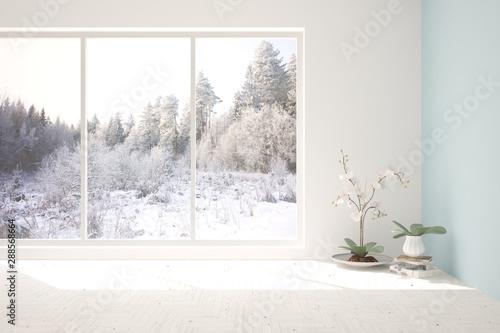 Obraz Mock up of empty room in white color with winter landscape in window. Scandinavian interior design. 3D illustration - fototapety do salonu