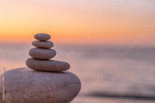 Perfect balance of stack of pebbles at seaside towards sunset Tablou Canvas