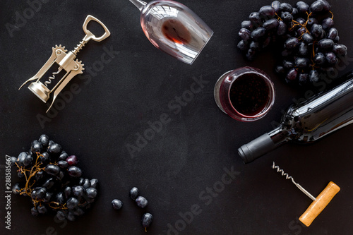Fototapety, obrazy: Frame with red wine bottle. Top view black background copy space