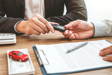 Sale Agent Giving Car Key To C...