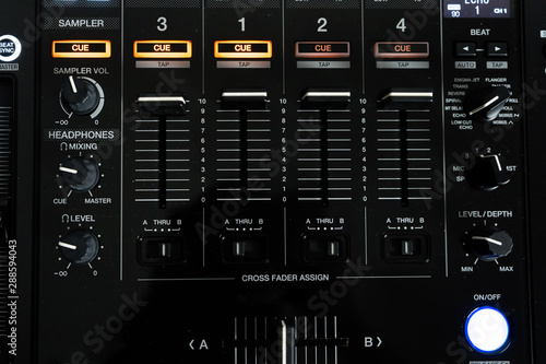 Fotografija Wide angle photo of black sound mixer controller with knobs and sliders