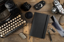 Vintage Retro Typewriter, Analog Film Camera And Notebook On Brown Wooden Table Background Top View Flat Lay From Above - Journalism Or Writer Concept