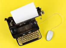 Antique Retro Mechanical Typewriter With Modern Computer Mouse On Yellow Background - Digitalization, Digitization Or Modernization Minimal Concept Flat Lay Top View From Above