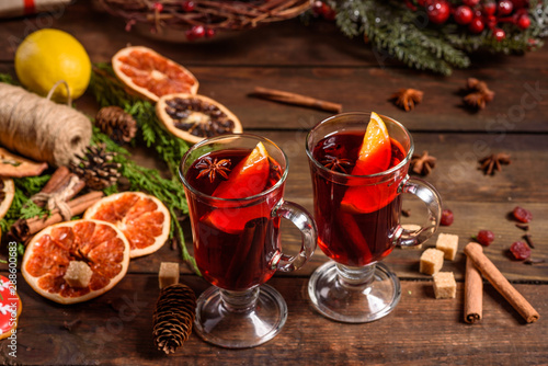 Christmas hot mulled wine with cinnamon cardamom and anise on wooden background - 288600683