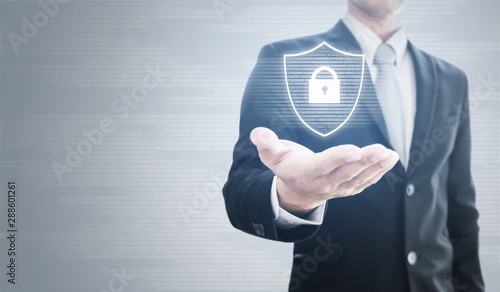 Businessman holding shield with security lock icon technology - 288601261