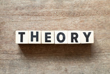 Letter Block In Word Theory On Wood Background