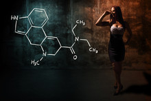 Sexy Girl Or Secretary Or Female Student Presenting Handdrawn Chemical Formula Of LSD