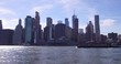 Financial District of Manhattan in the afternoon, view from Brooklyn Bridge Park.