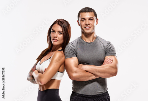 Fototapeta Portrait of two young fit sporty people with crossed hands obraz
