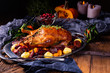 canvas print picture - roast duck with potato dumplings and plums