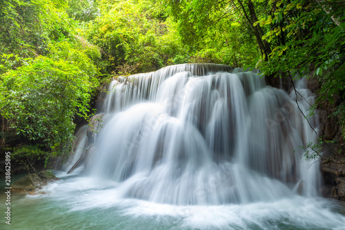 Wonderful  tiers of waterfall motion in deep jungle, Located Erawan waterfall Kanchanaburi province, Thailand - 288625895