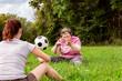 canvas print picture - Zwei geistig behinderte Frauen werfen sich einen Ball zu, Übungen für Koordination und Konzentration