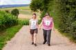 canvas print picture - Hand in Hand Lauf mit einer geistig behinderten Frau in der Natur, Inklusion und Hilfe