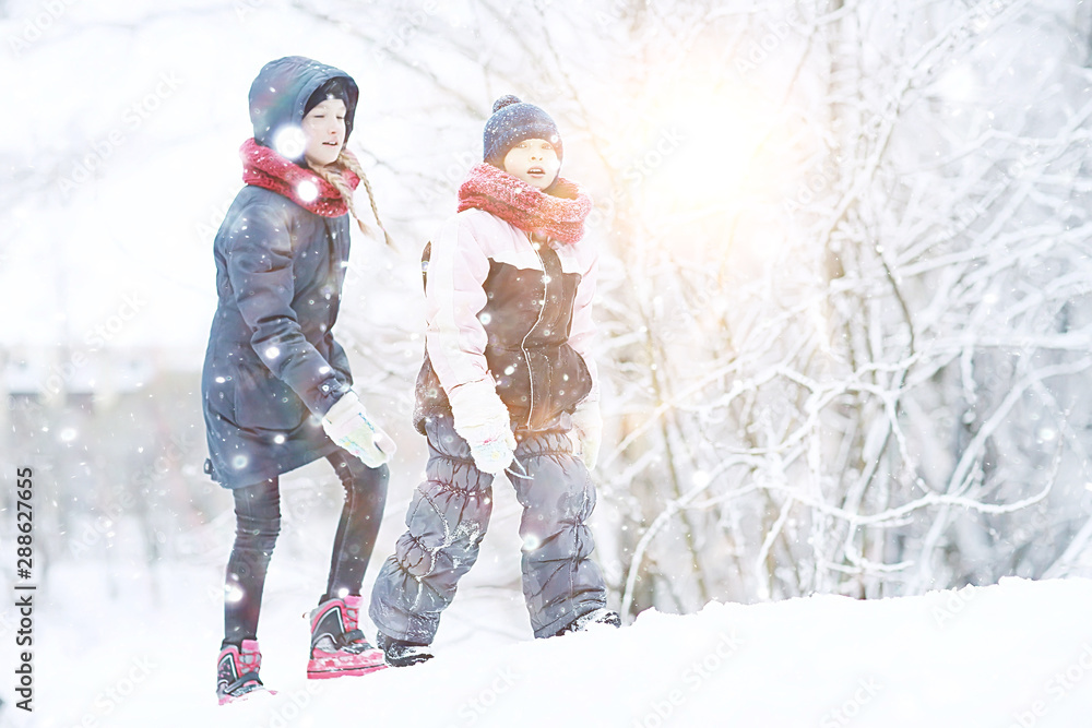 Fototapety, obrazy: two sisters girls  winter for a walk / young girlfriends playing in the snow in the frost. The concept of childhood, friendship, family. Sports warm clothes, health immunity. Christmas morning.