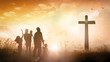 canvas print picture - Big family worship concept: Silhouette people looking for the cross on autumn sunrise background