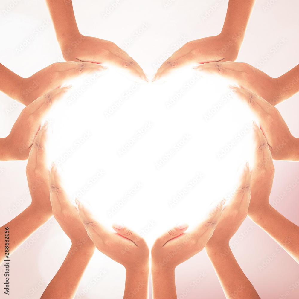 Fototapety, obrazy: International human solidarity day concept: Human hands in shape of heart on blurred natural background