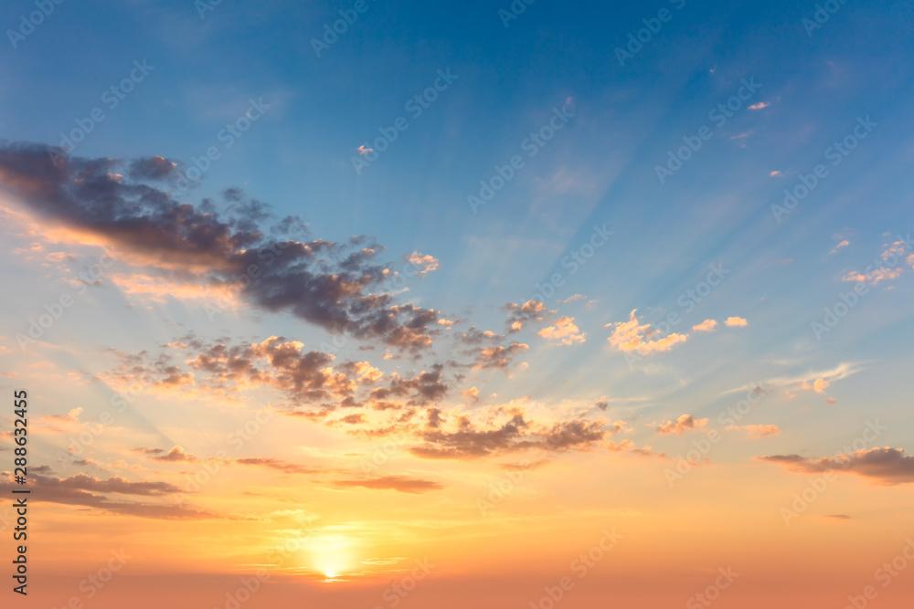 Fototapeta Sunrise sundown sky with  soft clouds and sunbeams