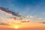 Sunrise sundown sky with  soft clouds and sunbeams