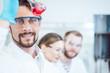 Leinwanddruck Bild Analytical Chemist analyzing a red solution