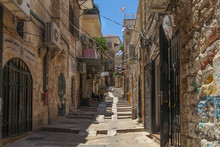 Narrow Street In The Jerusalem Old City, Israel With Traditional Houses.