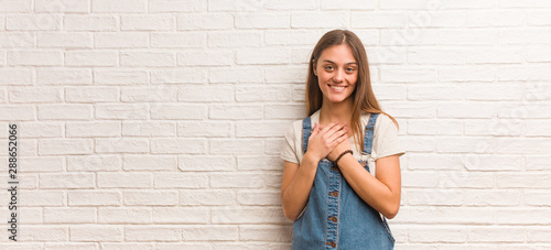 Valokuvatapetti Young hipster woman doing a romantic gesture