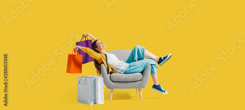Photo Stands Coffee bar Cheerful shopaholic woman with shopping bags