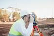 surveyor man in white helmet on construction site
