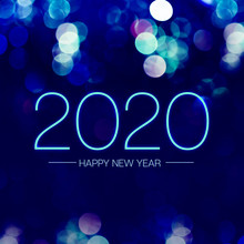 Happy New Year 2020 With Blue Bokeh Light Sparkling On Dark Blue Purple Background,Holiday Greeting Card.