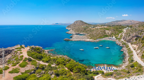 Poster de jardin Europe Méditérranéenne Aerial birds eye view drone photo Ladiko bay near Anthony Quinn on Rhodes island, Dodecanese, Greece. Panorama with nice lagoon and clear blue water. Famous tourist destination in South Europe