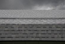 Wet Black Shingle Roof While R...